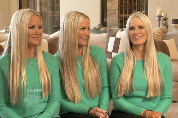 Jaclyn, Erica, and Nicole sat in a line wearing matching green hoodies with their blonde hair worn straight down