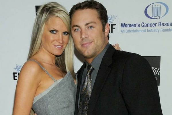 Erica wearing a gray dress with Jay McGraw wearing a suit and grey shirt together on the red carpet