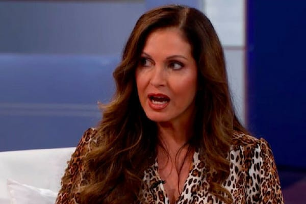Journalist Lisa Guerrero wearing a leopard print top while on the set of The Doctors discussing home DNA test kits