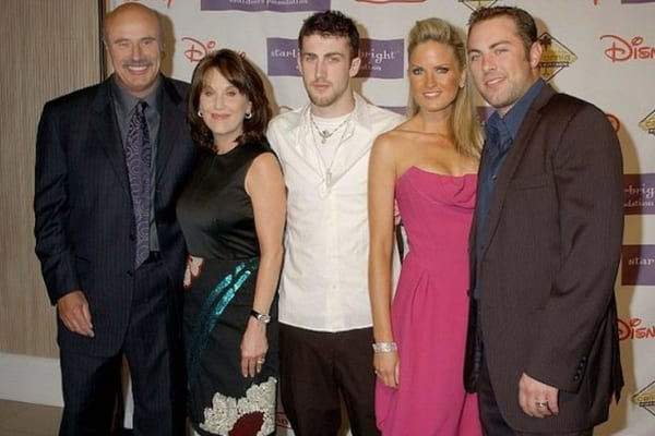 Dr. Phil and his wife Robin McGraw, with Erica and her husband, Jay McGraw, standing together on the red carpet