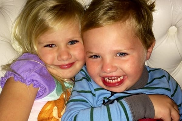 Avery Elizabeth McGraw hugging her brother London Philip McGraw while they both wear their pajamas in bed