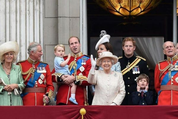 Queen Elizabeth II surrounded by Prince William and Kate, Prince Charles and Camilla, Prince Harry, and Prince Philip on the balcony of Buckingham Palace