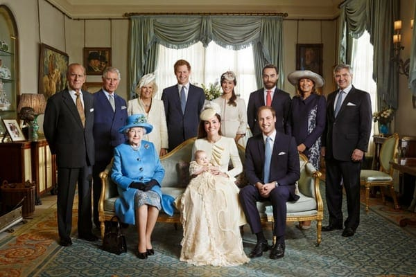 The official photo of Prince George's christening back in 2013 with Kate Middleton holding her son while sat next to Queen Elizabeth II
