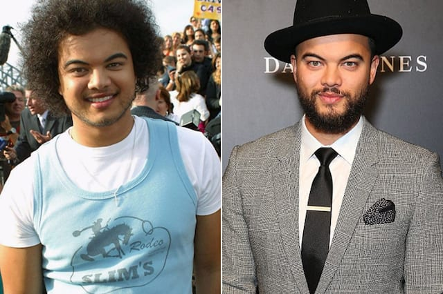 Guy Sebastian wearing a blue tank top on the left, and Guy a lot slimmer in a gray suit and black trilby hat on the right